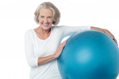 Senior women posing with exercise ball
