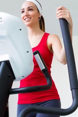 women on elliptical trainner