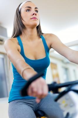 women riding a stationary bike
