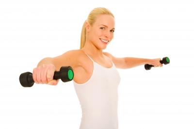 Blond girl lifting weights