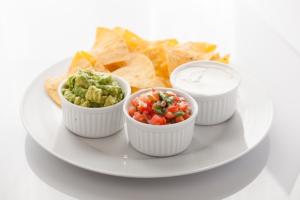 healthy tortilla chips, guacamole, salsa